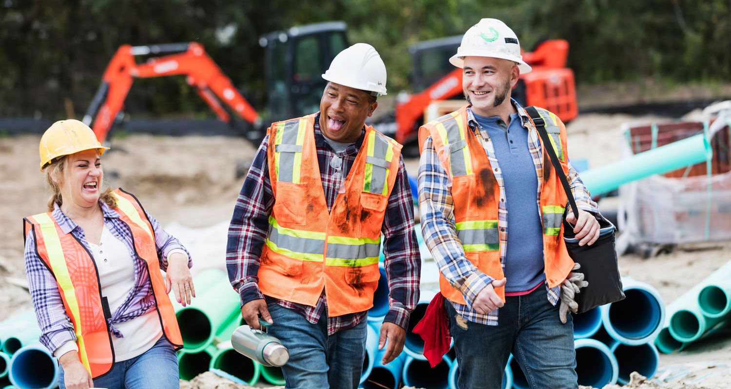 Construction workers share a laugh on-site.
