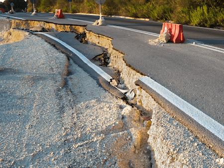 Earthquake damage on a road