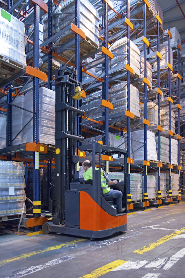 warehouse forklift in a warehouse with stacks of material