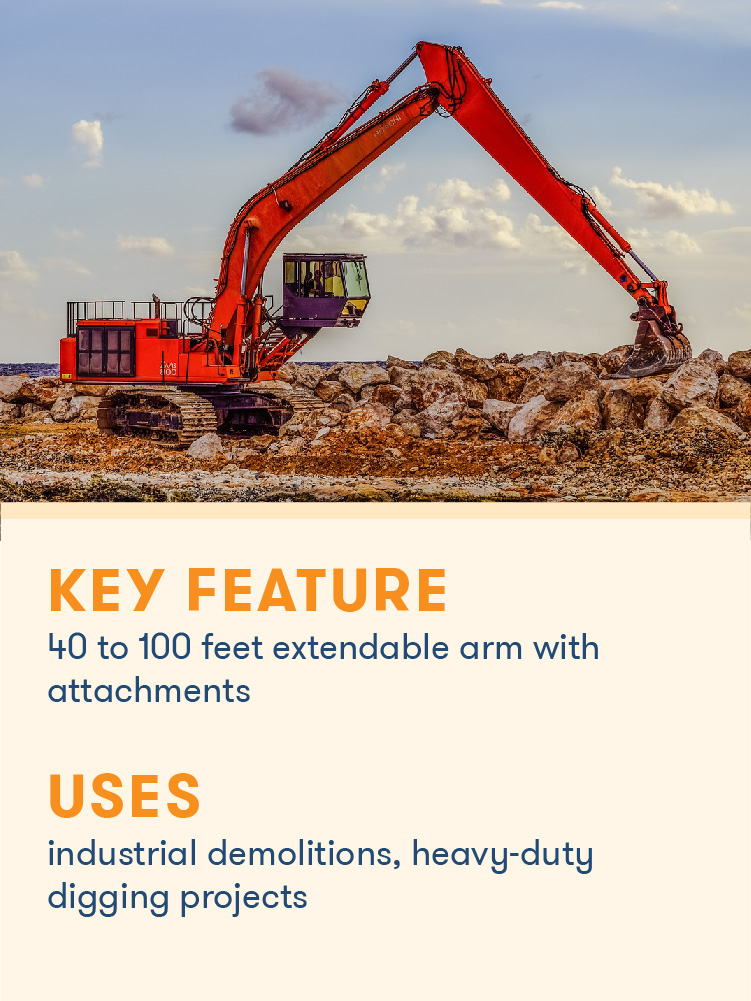 A long reach excavator uses its extendable arm.