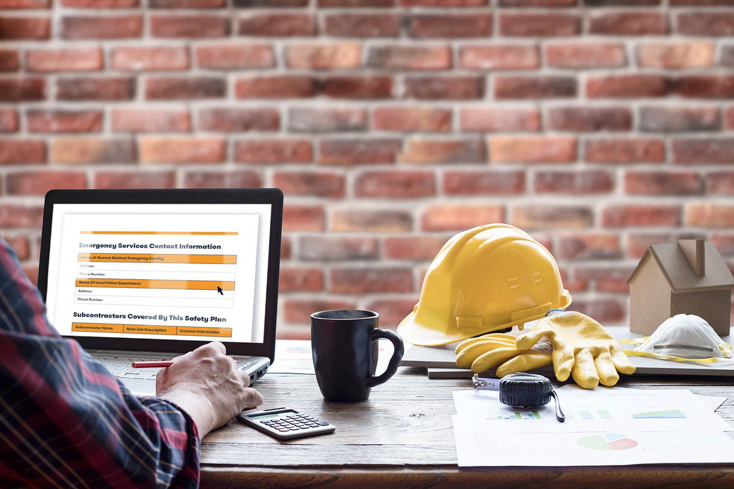 construction safety plan being edited on a laptop