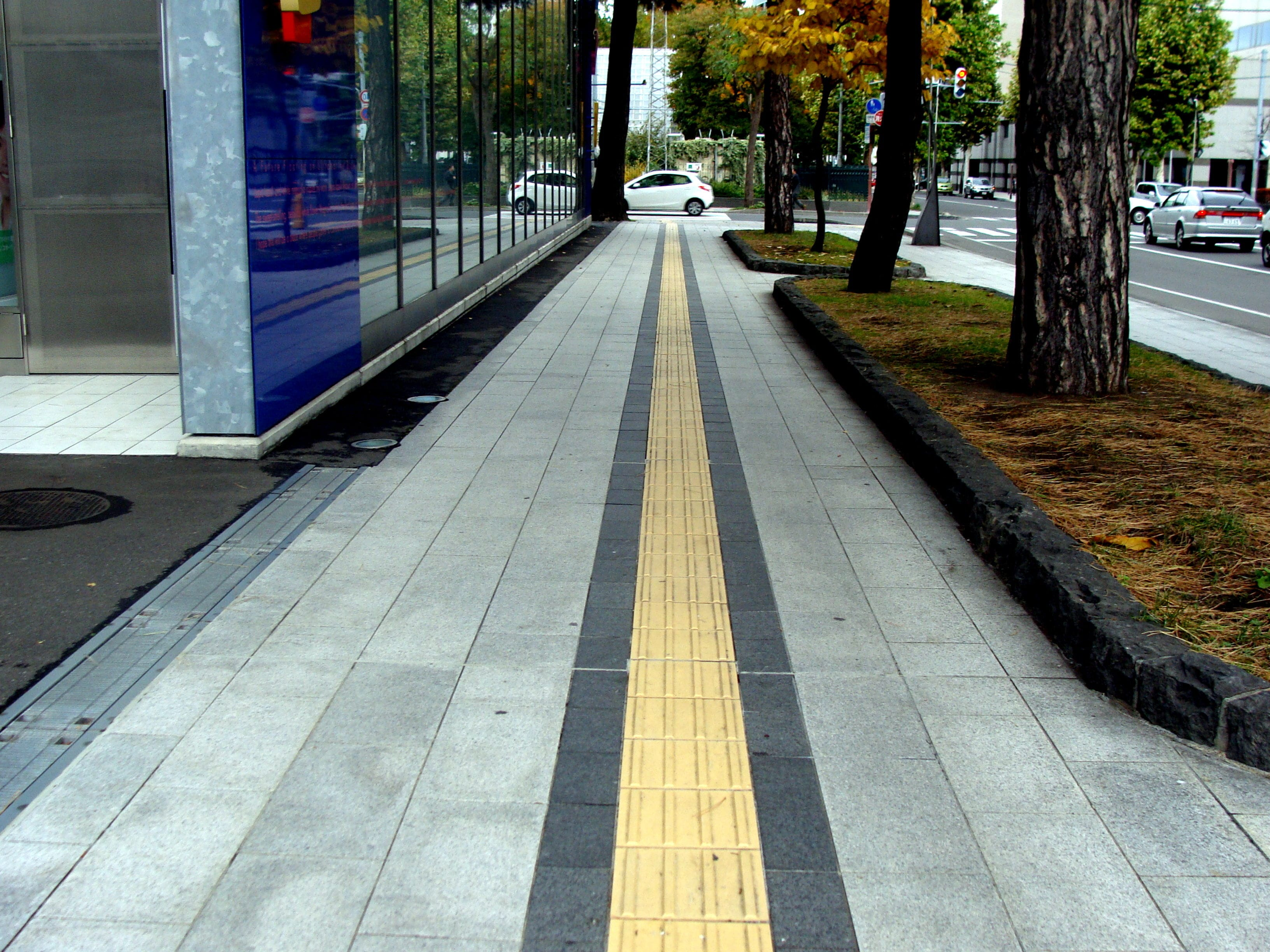 Tactile Ground Surface Indicators. Long yellow line along the sidewalk in Sapporo Japan