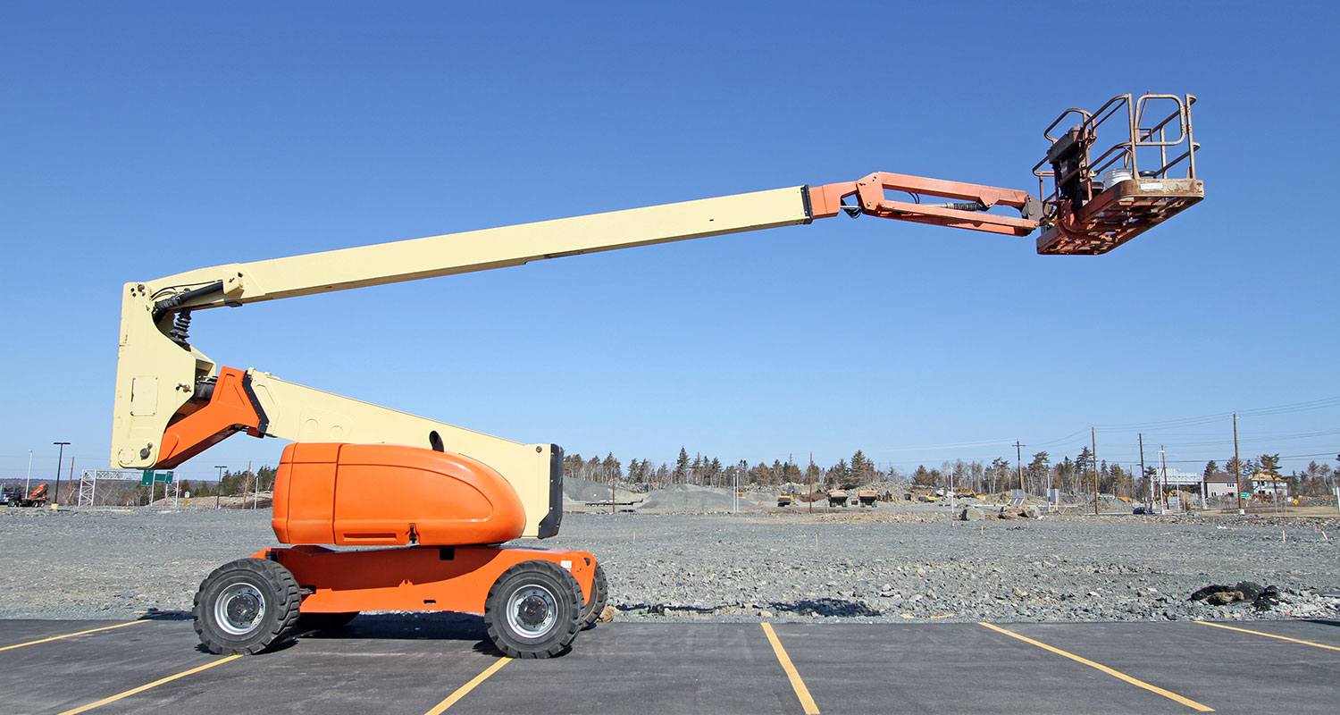 boom lift in a parking lot