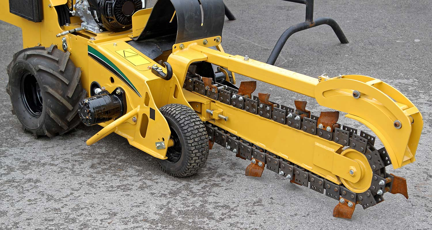 chain trencher on asphalt