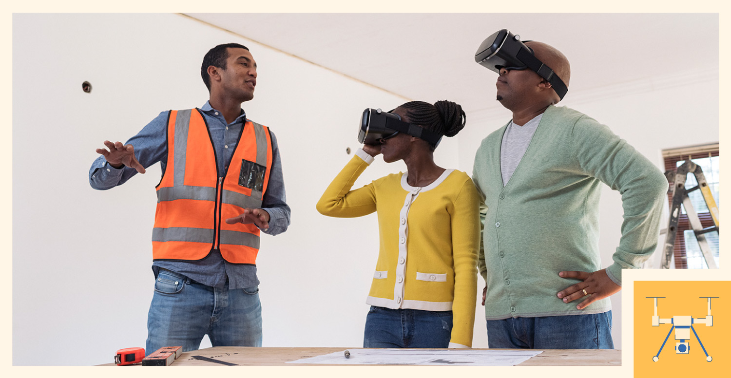 Construction worker using augmented reality glasses to show client the completed project