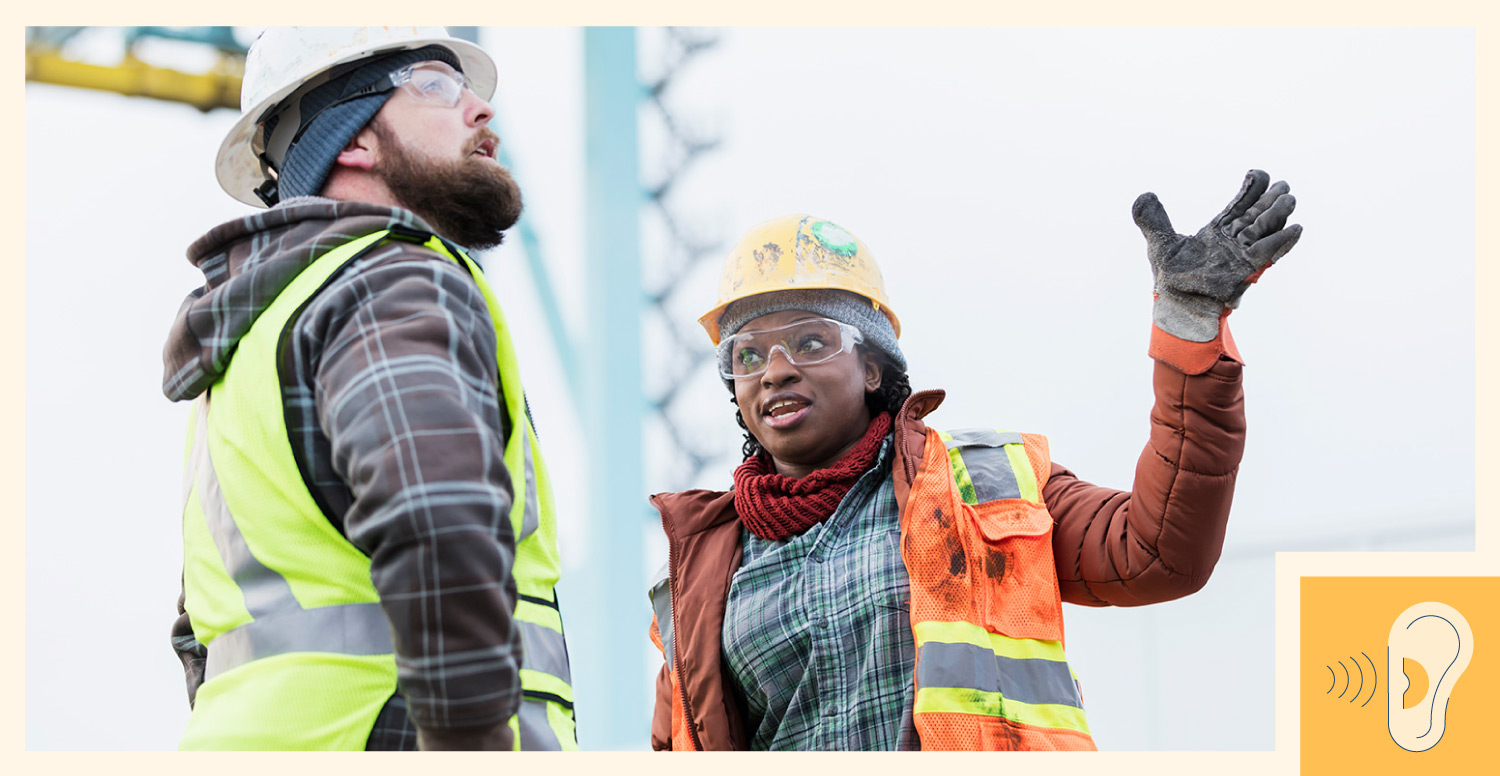 Two construction workers discussing project outside