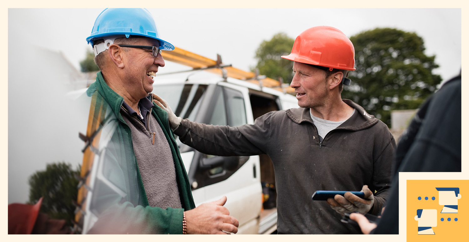 construction workers talking about project outside