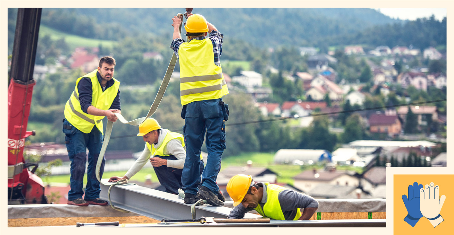A group of construction workers working together to suspend a steel beam.