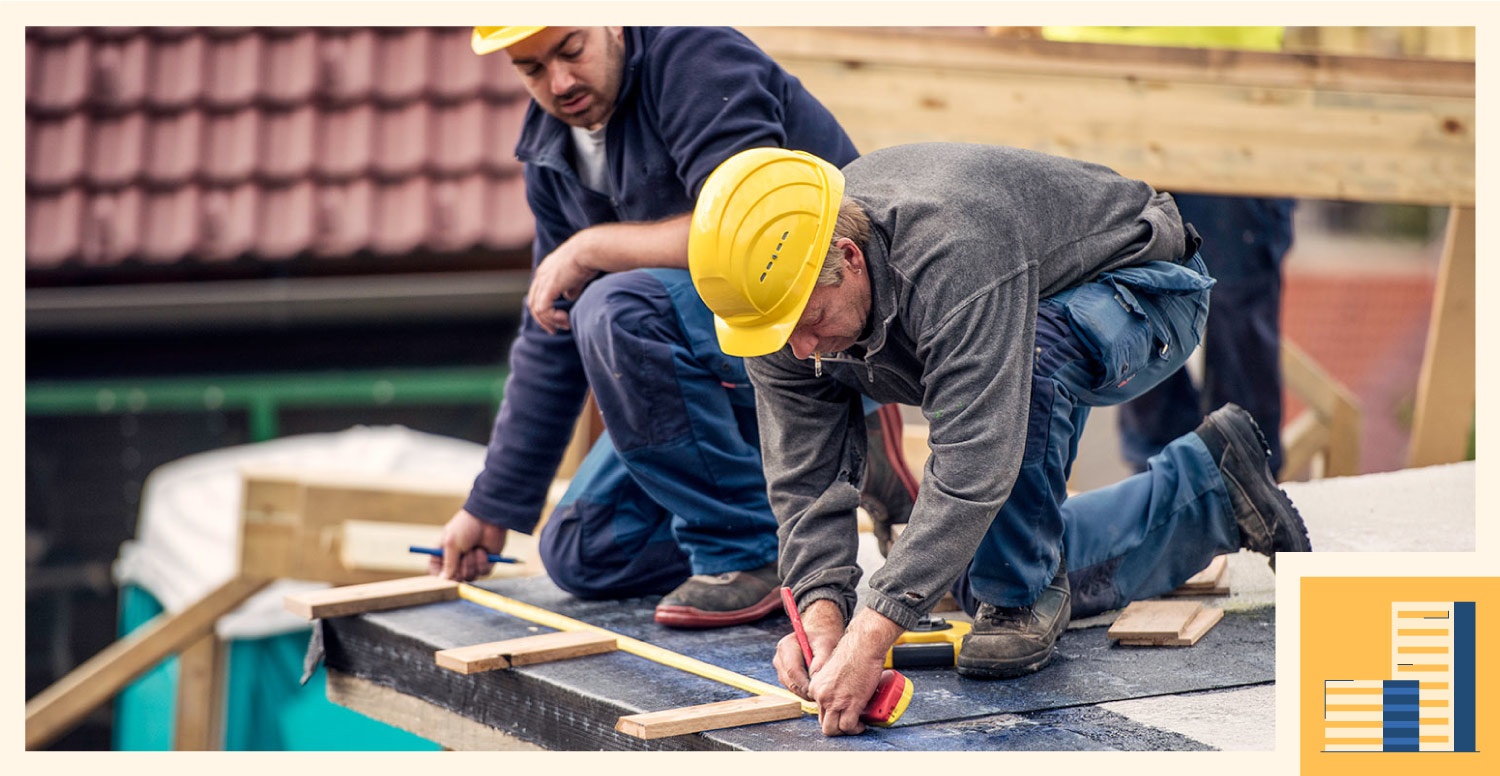 A construction workers makes measurements during a building project.