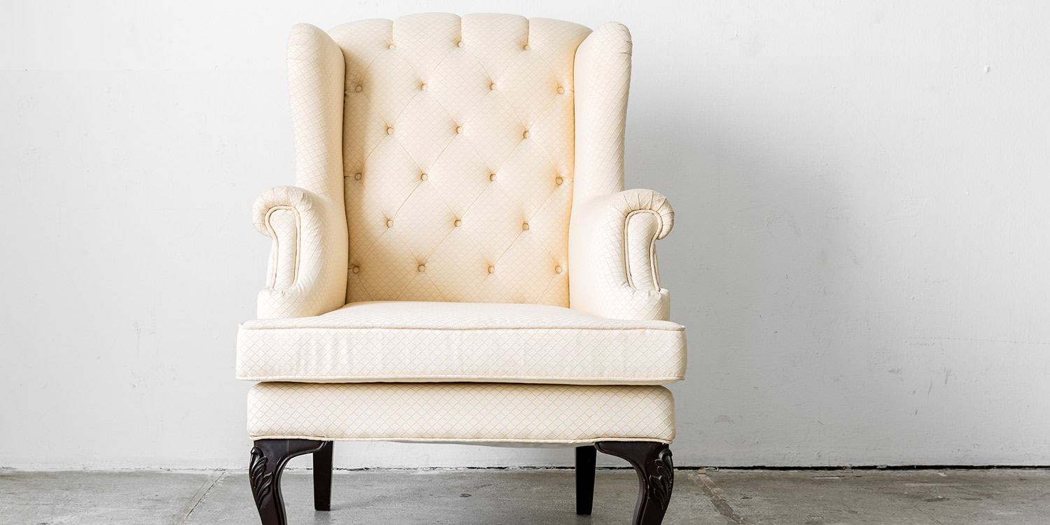 White upholstered wooden chair
